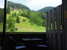 Balcony with table & x2 chairs and views of the mountain behind. Quiet and secluded